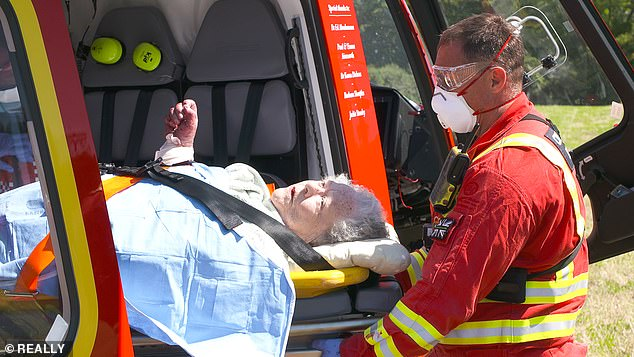 When the paramedics arrived on the scene, Annette has her arm, which is bleeding heavily, elevated in the air. Pictured, paramedics take patient Annette to the air ambulance
