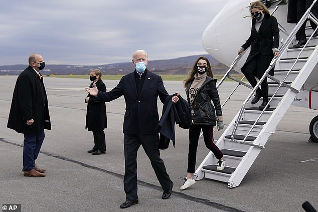 Biden steps off the airplane at Wilkes-Barre Scranton International Airport with granddaughters Finnegan and Natalie. He told reporters in Delaware they were 'going home'