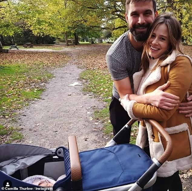 'Tired eyes but happy smiles': Camilla Thurlow and Jamie Jewitt appeared to be settling into parenthood as they took their one-week-old daughter for a walk on Tuesday