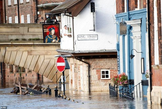 The pub and around half a dozen vehicles in the city were said to be marooned by rising water levels which are expected to peak overnight