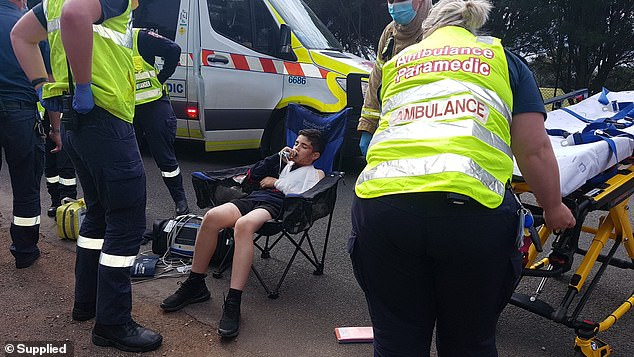 The 47-year-old told Daily Mail Australia that by the time he realised the danger they were in, it was too late. Pictured: Seth int he care of emergency workers