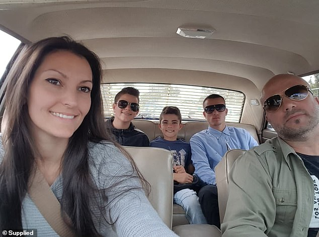 Pictured: The family-of-five inside the red 1967 Ford months before the accident