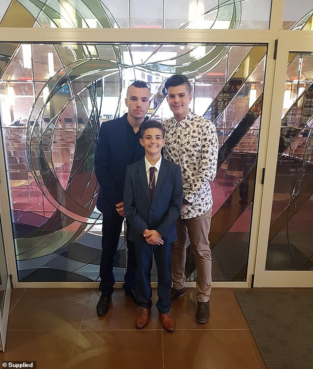 The former landscaping designer said he was 'getting back on his feet' after an accident 12 years earlier, is paralysed with devastation (pictured: his three sons)