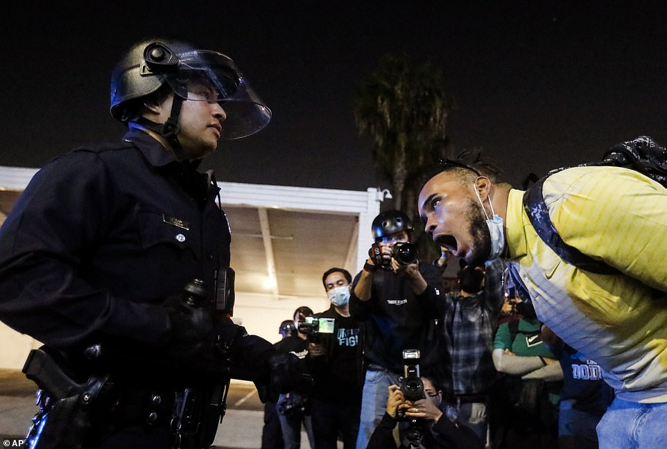LOS ANGELES:A man yells at a police officer during a protest in LA, California on election day