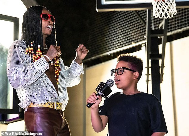 Co-parent: Rose also has 50/50 joint custody of seven-year-old son Sebastian 'Bash' Taylor (R) from her 14-month marriage to 10-time Grammy nominee Wiz Khalifa (L), which ended amicably in 2014 (pictured Saturday)