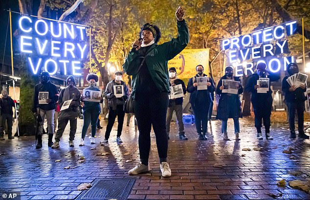 Travonna Thompson-Wiley, with Black Action Coalition, speaks at the Count Every Vote - Protect Every Person rally and march in Occidental Park in Seattle on Wednesday