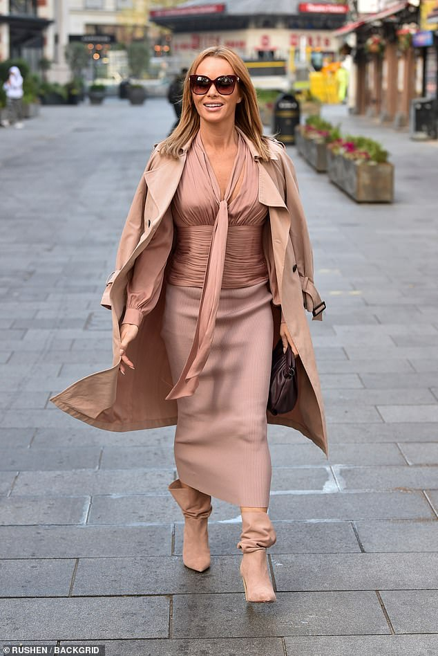 Amanda Holden looks stylish as she arrives at Heart FM in a pink ruched shirt and ribbed midi skirt