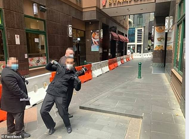 Private security guards outside of the Stamford Plaza Hotel in Melbourne during the pandemic