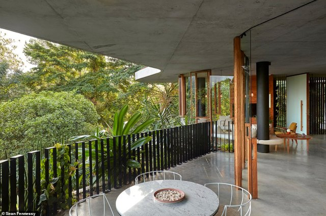 Planochella is completely unique, insofar as it is set in a secluded rainforest location and it features a curved concrete facade (pictured) that has been designed to integrate into the landscape over time