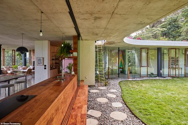 Jesse designed and built the Planchonella House himself with the help of just seven contractors, while Anne-Marie controlled the interior design (exterior pictured)