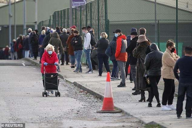 People queue at the coronavirus disease (COVID-19) testing centre in Liverpool, Britain November 6