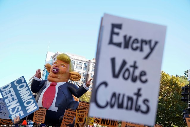 Protestors carried signs reading 'Every Vote Counts' as they marched towards the White House, November 6