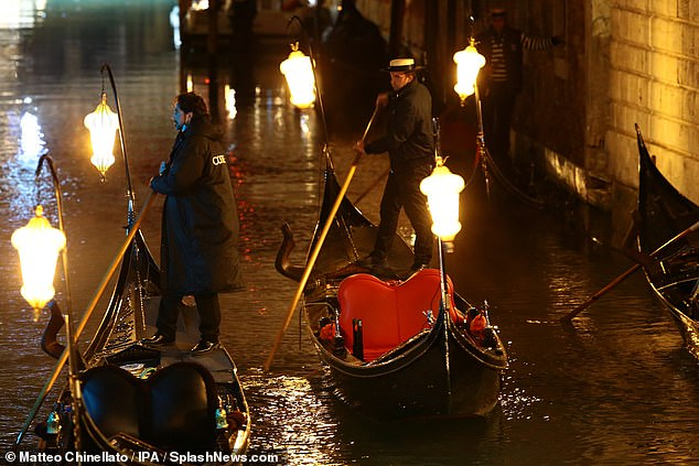 Sailing away: They prepared gondolas to row across the canal for the filming