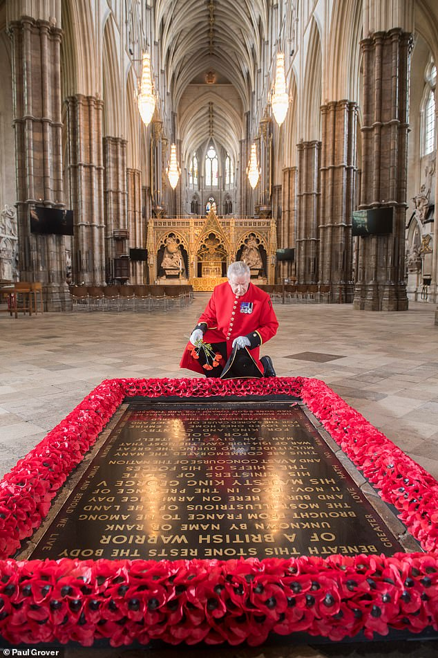 A Chelsea Pensioner, pictured, at the grave of the Unknown Soldier, who was removed from a military cemetery in either the Somme, the Aisne, Arras and Ypres