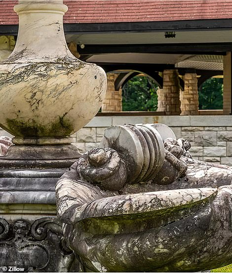 The marble-carved fountains (pictured) stopped functioning and the large elm tree on the grounds for which the property was named died of disease in the early 1960s