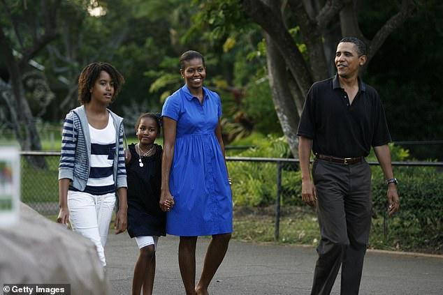 His Hawaii retreat is only two doors down from former US President Barack Obama's summer rental property (pictured Barack Obama with wife Michelle and daughters Malia and Sasha in Honololu)