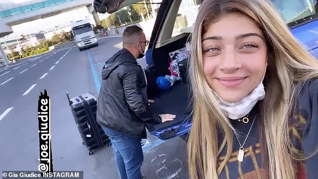 Beaming:Her older sister Gia, 19, also shared a video of her with dad Joe as he was loading the car