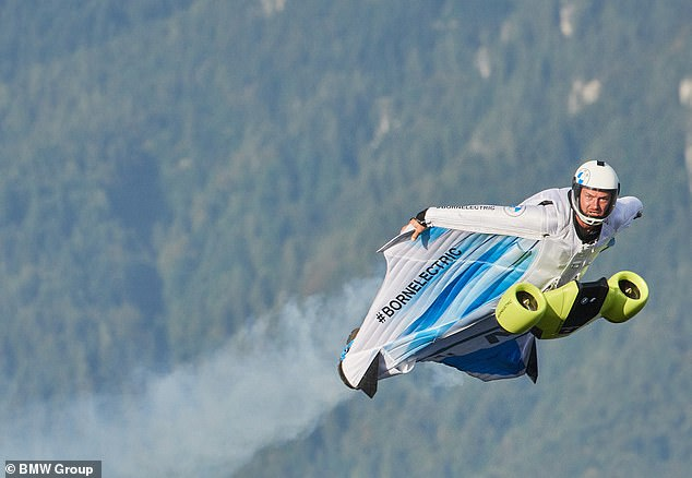 BMW is taking passengers to new heights with the first electric driving system for a wingsuit that hits speeds of 186 miles per - traditional suits only reach 62 miles per hour