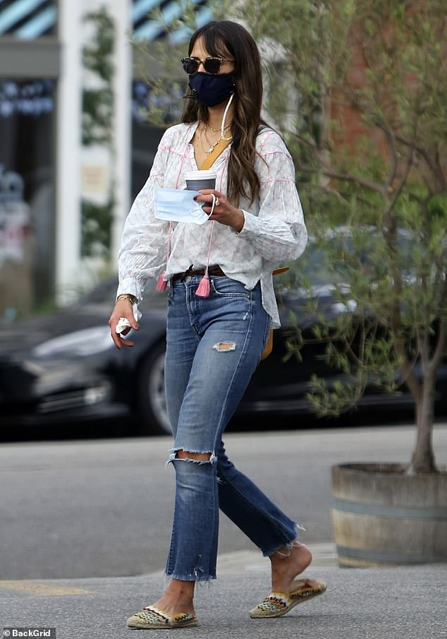 Coffee run: Jordana Brewster, 40, grabs coffee with new beau Mason Morfit, 44, and her four-year-old son Rowan. The Fast & Furious actress stepped out in a tunic top and ripped jeans as she and her boys stopped for a midday pick-me-up