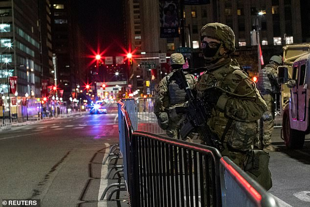 National Guard members stand guard near Philadelphia City Hall on Thursday night