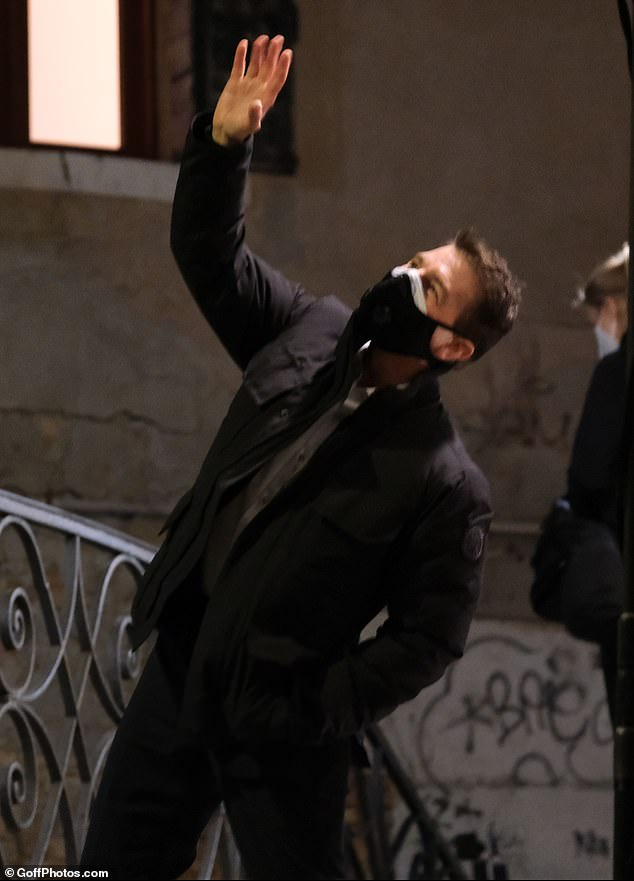 Jovial: Tom was raring to go as he happily waved to onlookers as he headed to film more scenes in the Italian city