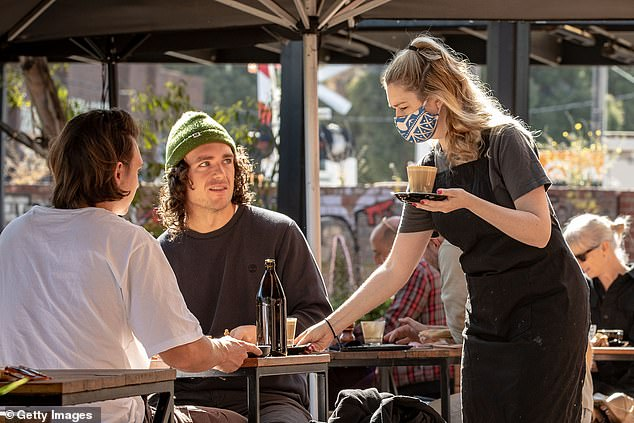 Australian workers may have to wait years for a pay rise as companies tighten their purse strings in the wake of the coronavirus crisis (pictured, a Melbourne cafe on October 28)