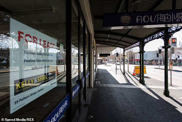 In the final quarter of 2020, the RBA expects the unemployment rate to reach a peak of eight per cent this quarter and ease to about six per cent by the end of 2022 (pictured, Lygon Street in Melbourne is seen deserted on August 9)