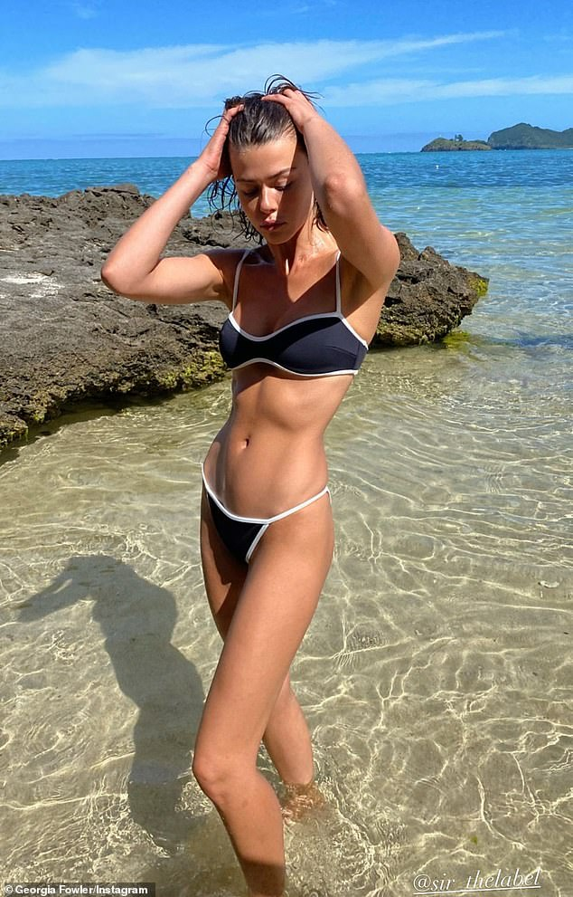 Beach babe! On Saturday,Georgia Fowler showed off her incredible figure in a TINY string bikini at the beach - after revealing her top tips and tricks for staying in shape and being body confident