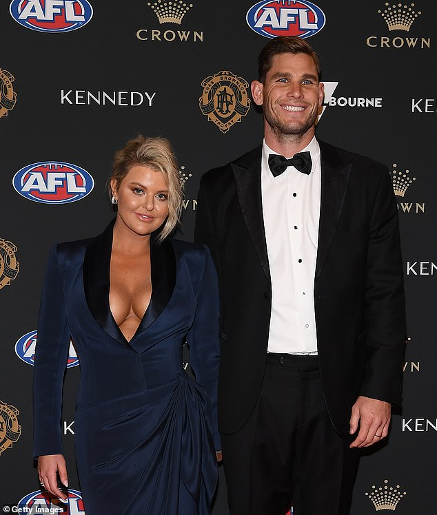 Champion Geelong forward Tom Hawkins (pictured last year with wife Emma Hawkins) reportedly confronted Gary about his marital split