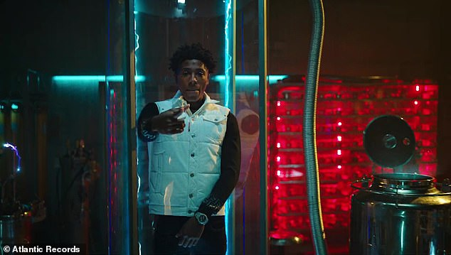 Sci-fi: The video opened with Mike, a scientist of some sort, working on a computer screen as YoungBoy materialised out of thin air in a large plastic tube behind him
