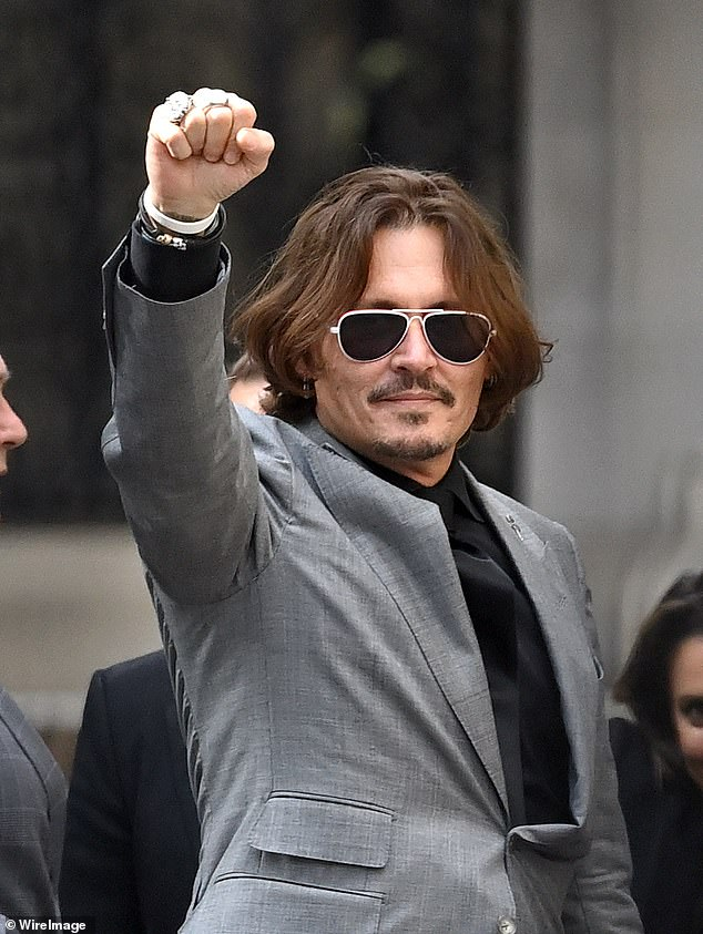 Legal battle: Depp had sued News Group Newspapers, publisher of The Sun, and its executive editor, Dan Wootton, over a 2018 article accusing him of assaulting Heard (pictured in July)
