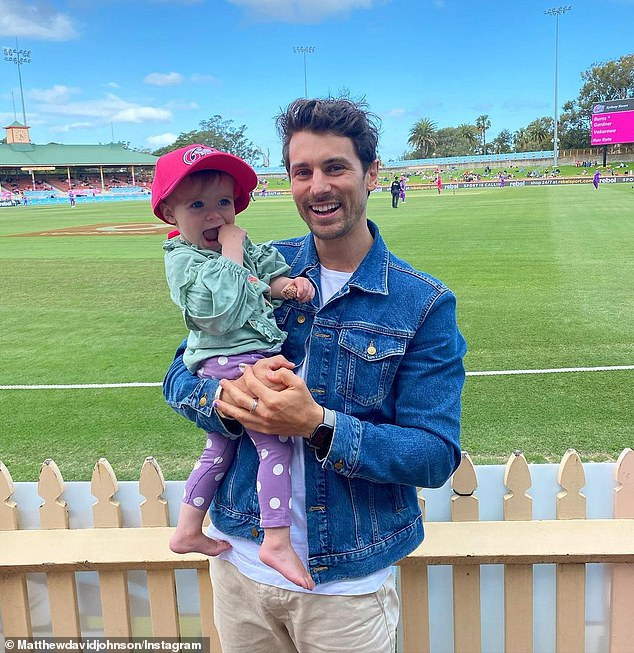 A league of their own! Former Bachelor Matty Johnson, 33, enjoyed a family day at the cricket with pregnant fiancée Laura Byrne and their adorable one-year-old daughter Marlie-Mae, in Sydney on Saturday. Pictured: Matty and Marlie-Mae