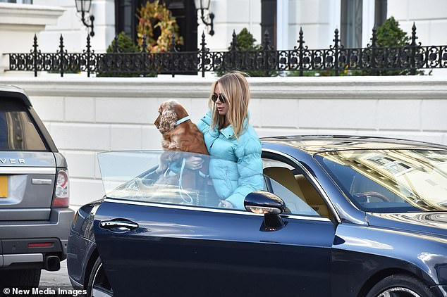 Sunny: Kimberley donned a pair of black sunglasses as she got out of the car