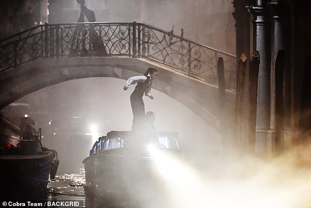 Leaping into action: The actress shot the thrilling shoot during a night shoot alongside Tom
