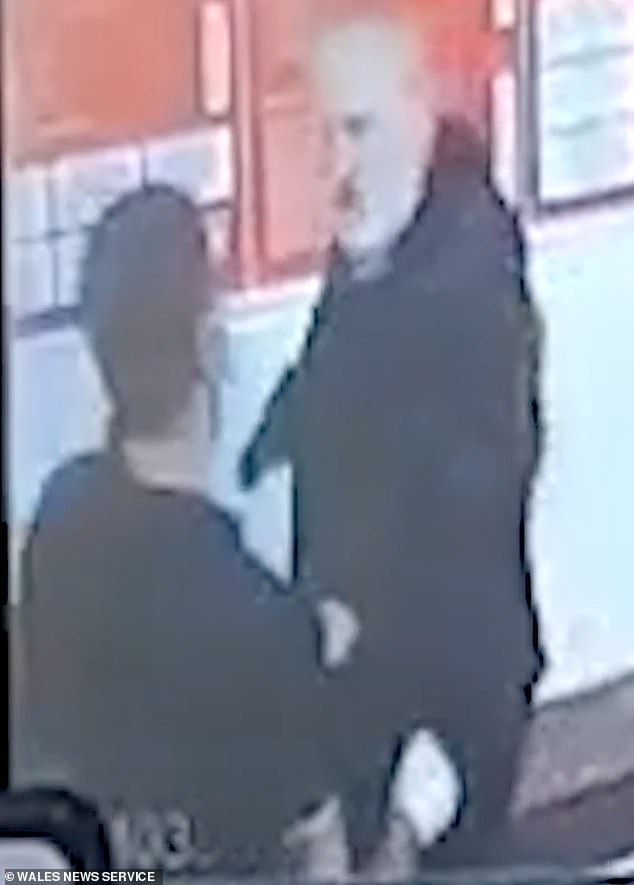 CCTV images show the row flared when the customer (right) was asked to wear a face covering by the delivery driver (left) on Thursday night while in the takeaway in the village
