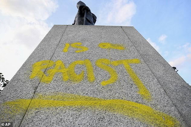 Clark was arrested after the plinth of a monument to Winston Churchill in Parliament Square, London was defaced in September with yellow graffiti including the words 'is a racist'