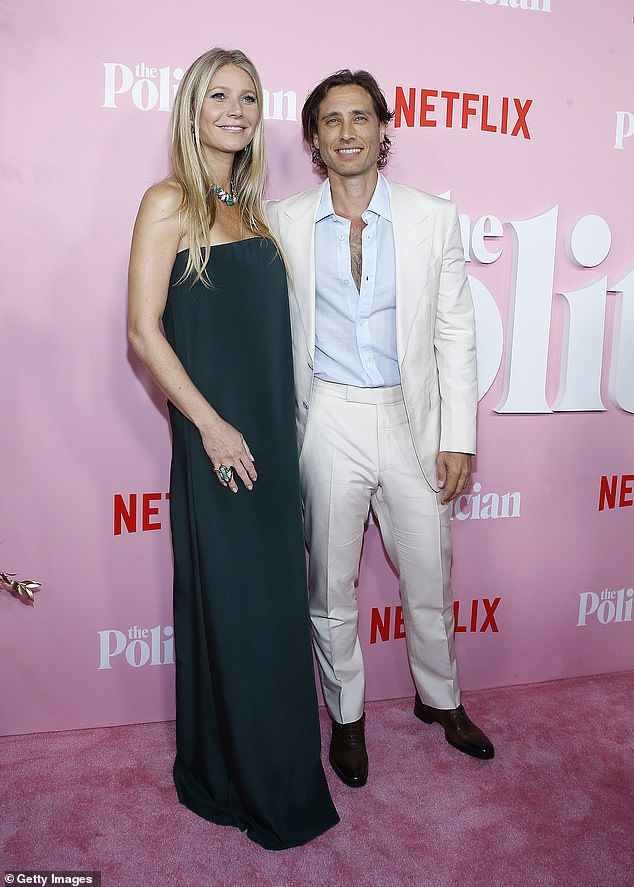 Love story:Following the split, Gwyneth began dating Brad, whom she originally met on the set of Glee, and the pair, eventually, wed in 2018; Gwyneth and Brad pictured in 2019