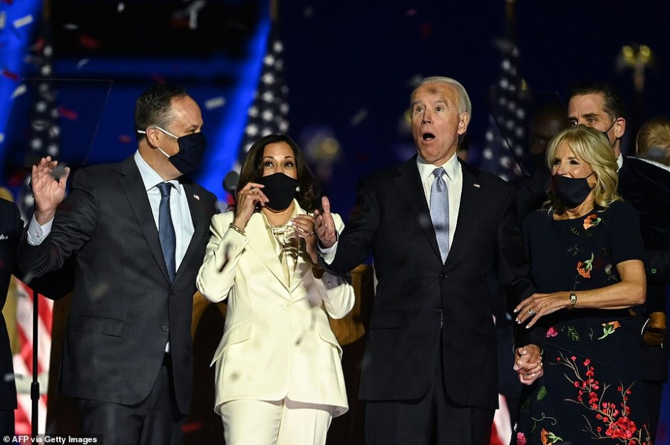 In his 15-minute speech to the country, Biden called on Americans to come together andmade an appeal to Trump voters. The president-elect and Kamala Harris are seen reacting to the crowd alongside their respective spouses