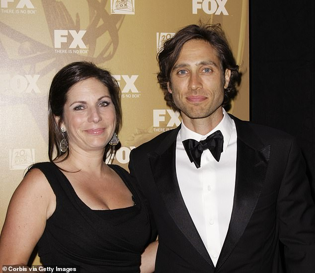 Divorced:Brad and his ex Suzanne, whom he divorced in 2013 after nearly 20-years of marriage, share daughter Isabella and son Brody; Suzanne and Brad pictured