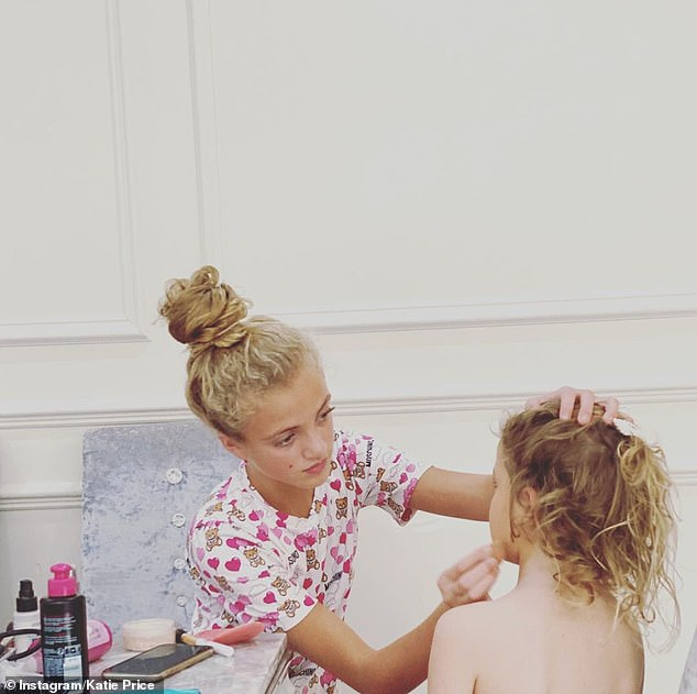 Sisters: Katie shared a photo of her daughter, the Princess, putting on makeup in her kitchen