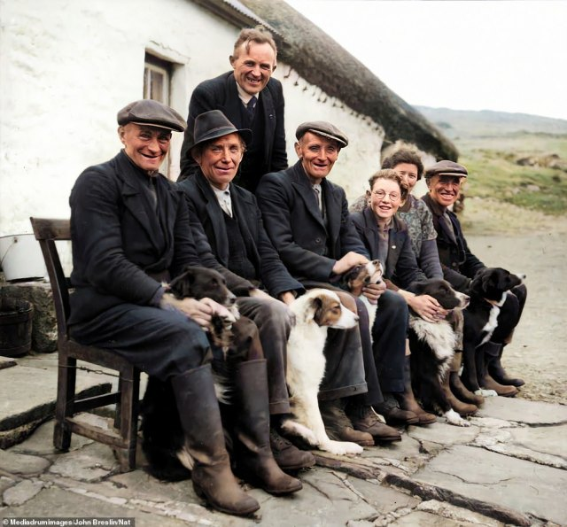 Several generations pose for a picture with their dogs in the Blue Stack Mountains in 1950. Pictured here areNiall de Búrca, Joe Mac an Luain, Seán Ó hEochaidh, John Mac an Luain, Joe Beag Mhic an Luain, Máire Bean Mhic an Luain and Pat Mac an Luain. The man standing up, Seán Ó hEochaidh, was a collector of folklore in his native Irish language, gathering tales from Donegal in a collection which was given to University College Dublin