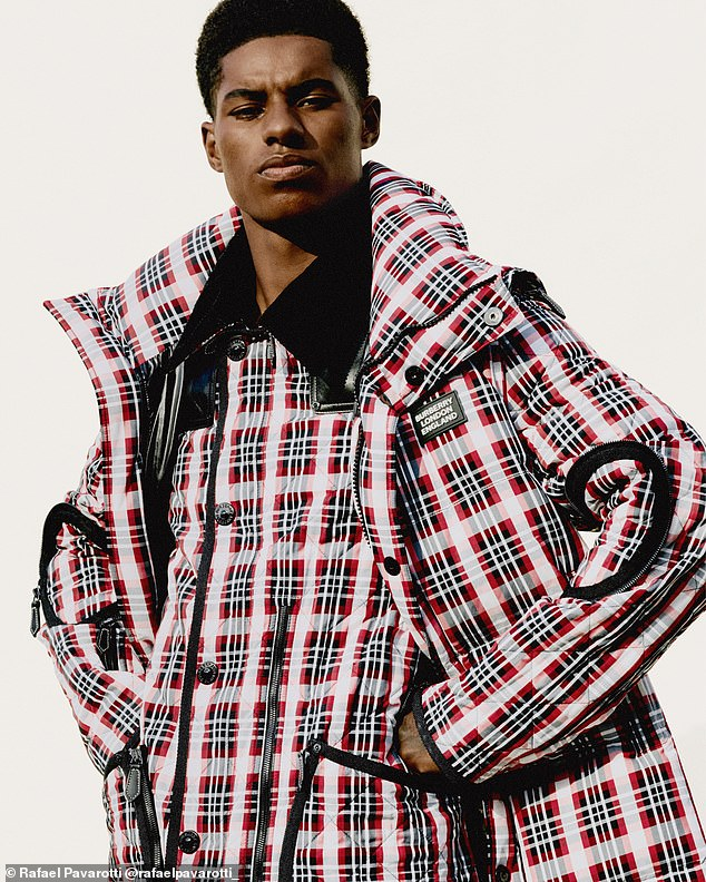 Bold:A third look saw Marcus rock an eye-catching pink and red checked jacket, which appeared to be layered over another jacket in the same print
