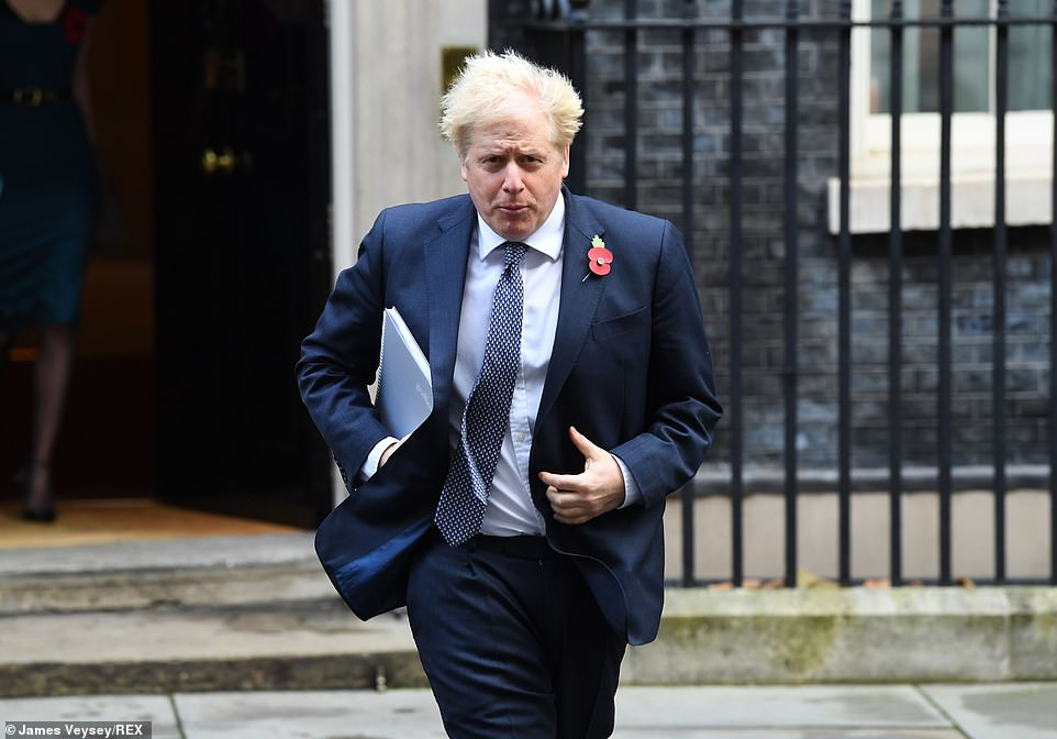 Boris Johnson, pictured leaving Downing Street this morning, promised the UK will be at the 'front of the pack' for the new coronavirus vaccine after the massive breakthrough