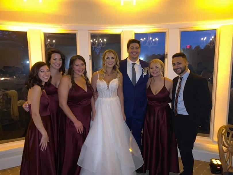 The New York couple whose wedding at an upscale Long Island country club flouted the state's gathering restrictions and became a 'superspreader' event linked to more than 30 COVID-19 cases have been identified as Cydnie Piscatello and James Rugnetta (pictured)