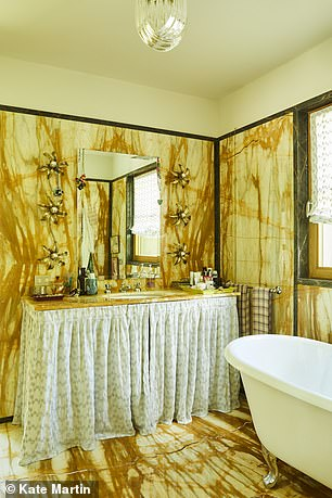 The luminous yellow 'Giallo di Siena' marble in the bathroom is a nod to her grandmother rosita's Milan apartment, where Margherita lived while at university