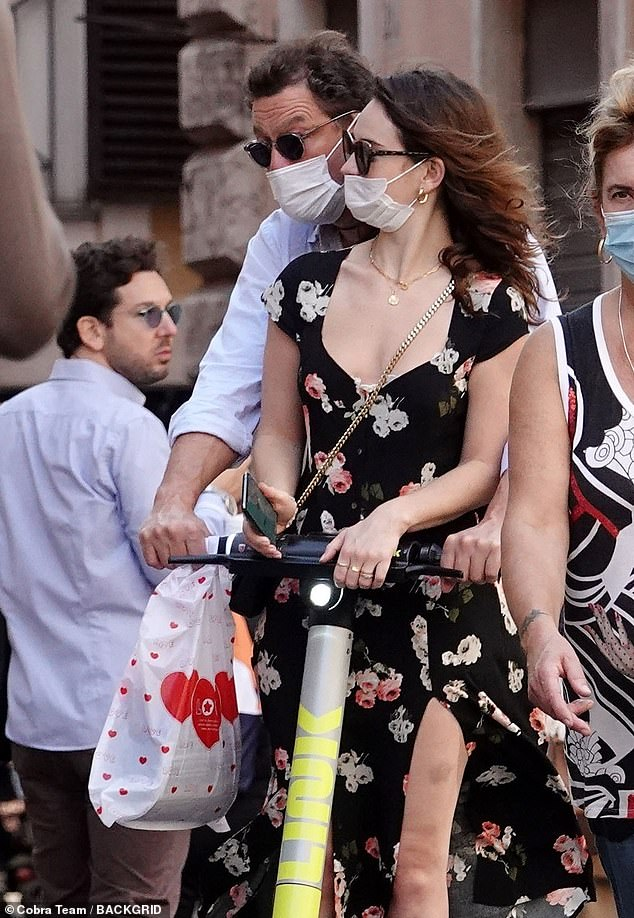 Breaking her silence: Catherine, 49, assured MailOnline that her marriage is 'fine', as friends confirmed she was determined to make her marriage work and avoid a divorce (Dominic and Lily pictured in Rome last month)
