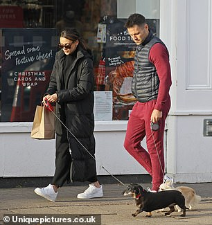 Relaxed: She and husband Mark were seen heading out for a stroll