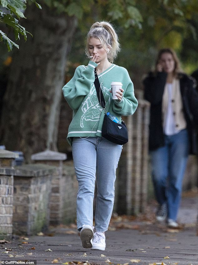 Lottie Moss, pictured, was pictured enjoying a cigarette and a hot drink as she walked from a West London coffee shop