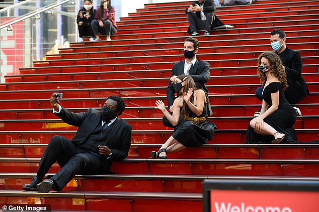 People wear face masks on November 10 at Red Steps in Times Square, a normally crowded attraction that sees hordes of tourists every day.