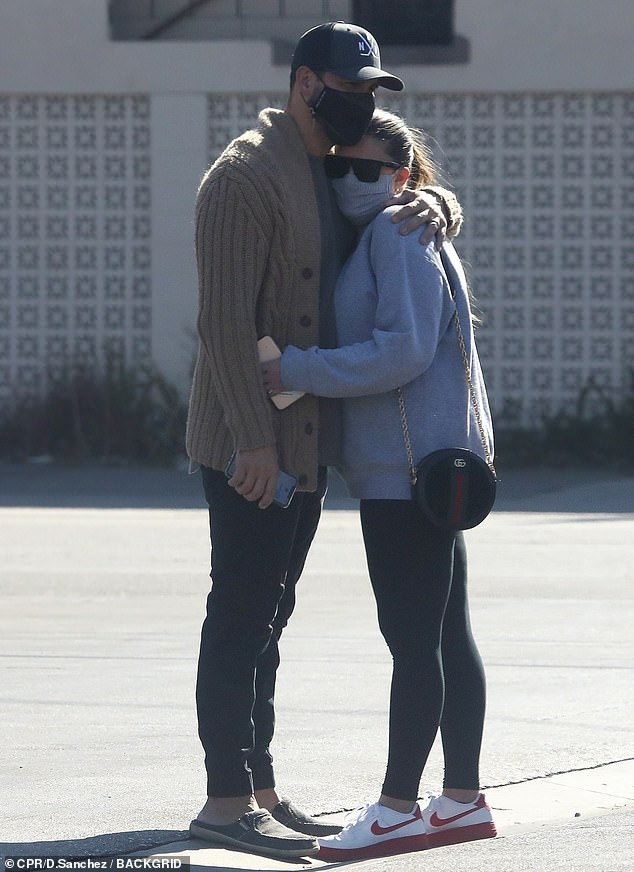 Cute:While on their way to the outdoor seating section, the two lovebirds stopped to share a sweet hug